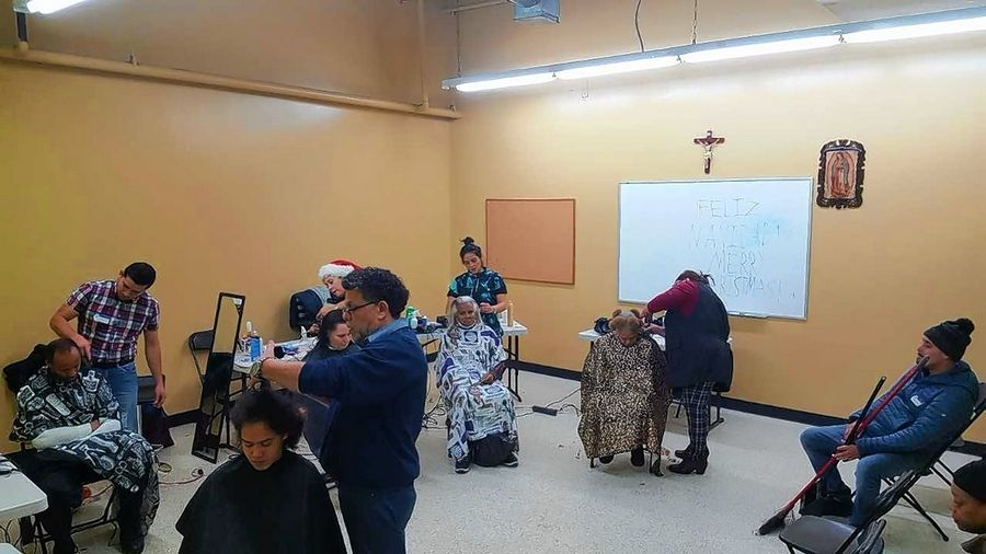 Volunteers with Caridades de la Cruz (Charities of the Cross) gave haircuts to homeless people at the fifth annual homeless fair at the Shrine of Our Lady of Guadalupe Pastoral Center in Des Plaines Saturday.