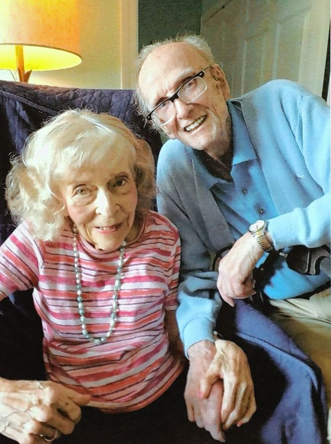 Posing for this photograph during their 60th wedding anniversary party, John and Jeanne Savely feared they would have to move from their home in a senior living community. But their daughter and members of local charities saved the day.