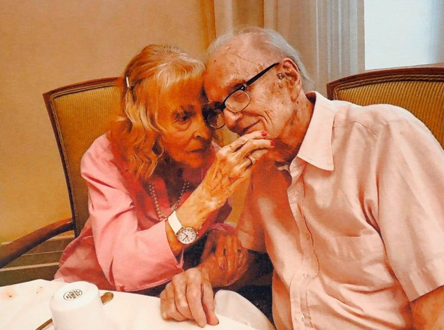 Celebrating his 95th birthday last June, John Savely shares a moment with Jeanne, his wife of 60 years.
