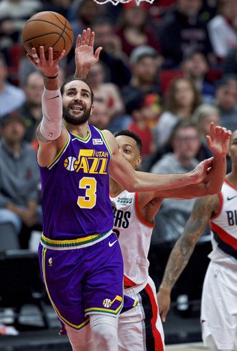 d6f6f73a0515 Utah Jazz guard Ricky Rubio shoots in front of Portland Trail Blazers guard  CJ McCollum during