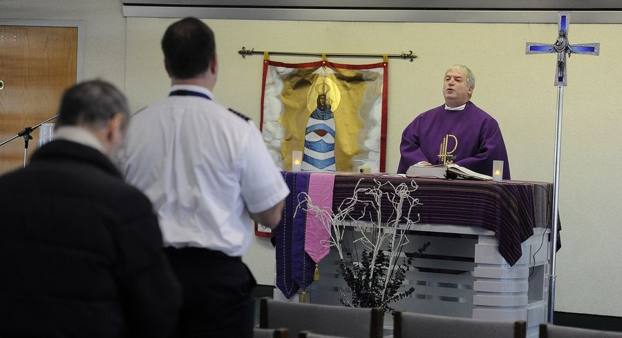 The Rev. Michael Zaniolo says Mass at O'Hare's Interfaith Airport Chapel, where two pilots are among the worshippers.