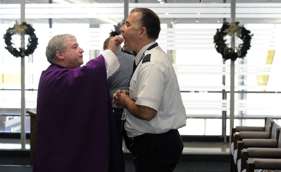 The Rev. Michael Zaniolo celebrates Mass at O'Hare International Airport's Interfaith Chapel with pilot John Racanelli of Columbus, Indiana, who flies for Spirit Airlines.
