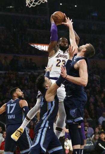 1515dde03 Los Angeles Lakers  LeBron James (23) passes as Memphis Grizzlies  Marc  Gasol