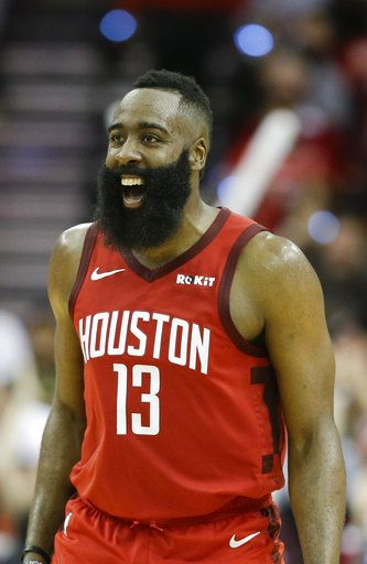 cced7f00c54 Houston Rockets guard James Harden reacts after guard Austin Rivers   three-point basket late