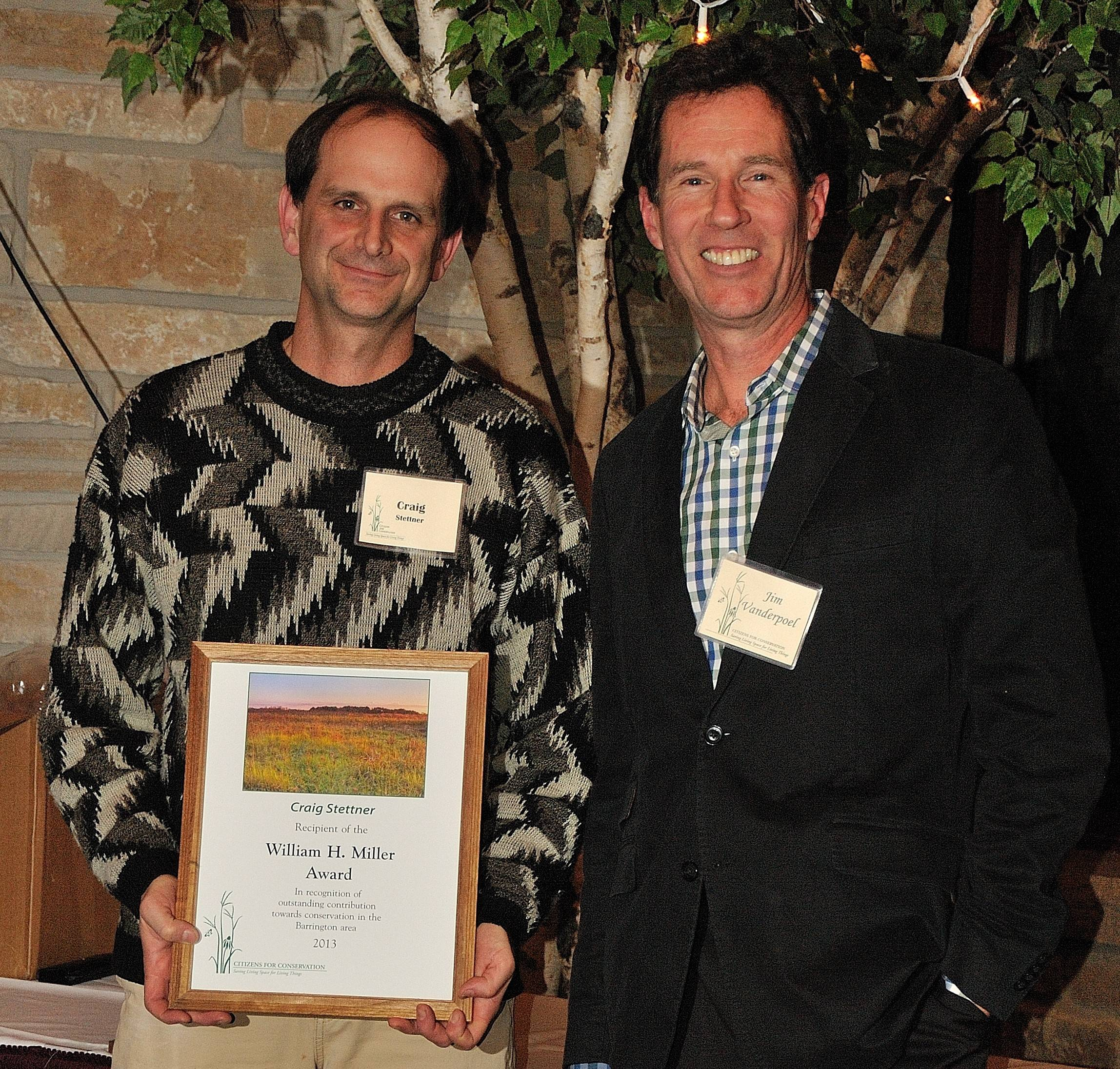 Harper College Associate Professor Craig Stettner, left, received an award in 2013 from Citizens for Conservation in Barrington for his many years of leading students to volunteer for local environmental organizations. Jim Vanderpoel of Citizens for Conservation presented the honor to Stettner.