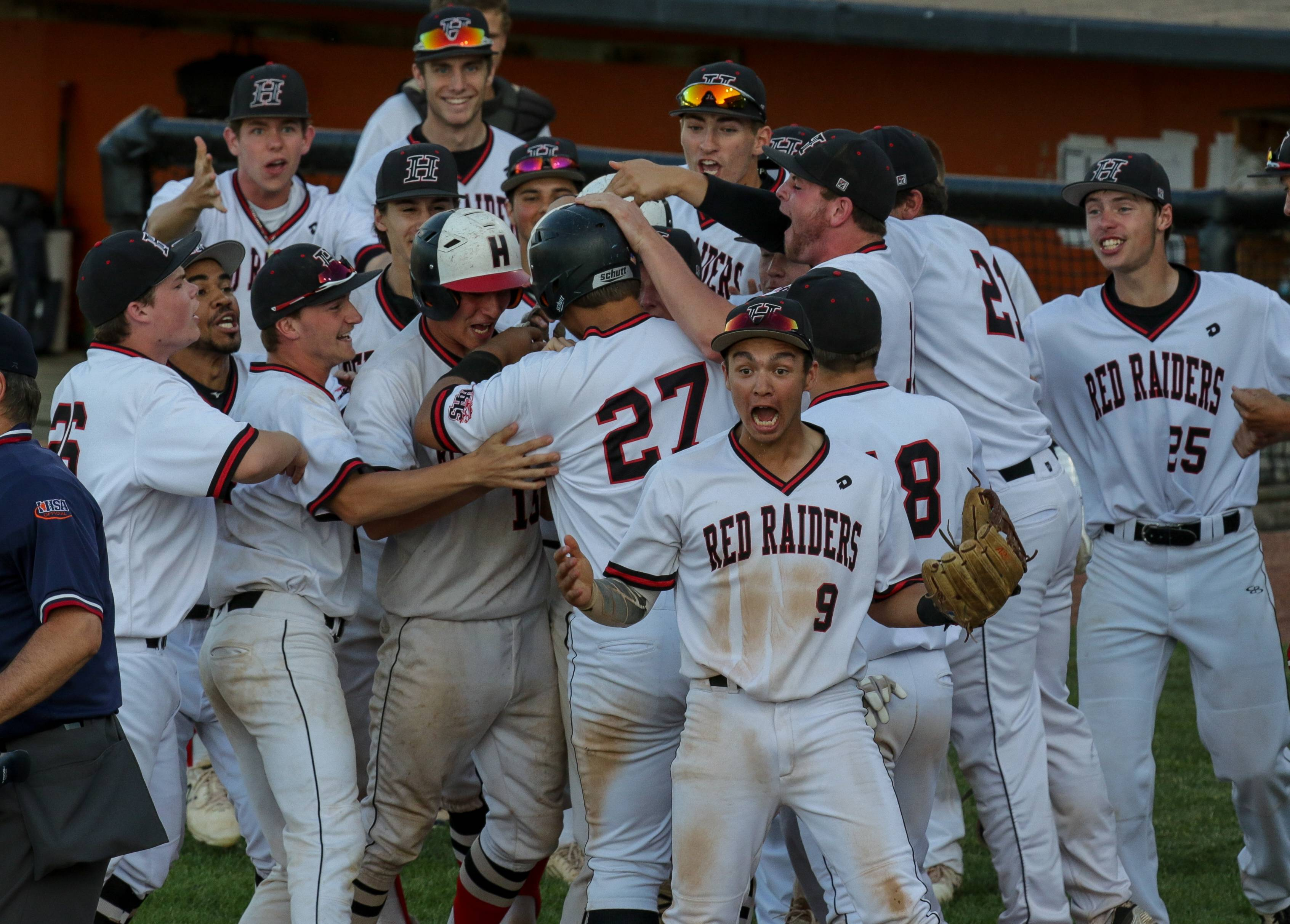 Matt Rodriguez (27) of Huntley is mobbed by teammates after hitting a home run in the 6th inning against Loyola in Class 4A sectional semifinal baseball at Boomers Stadium in Schaumburg.