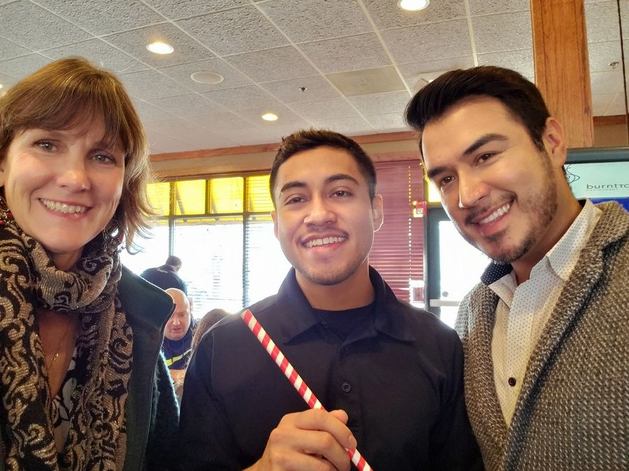 Defenders Executive Director Cynthia Kanner, left, joins Burnt Toast employee Fernando Mendoza and manager Edgar Huerta show the paper straws offered for shakes and smoothies.