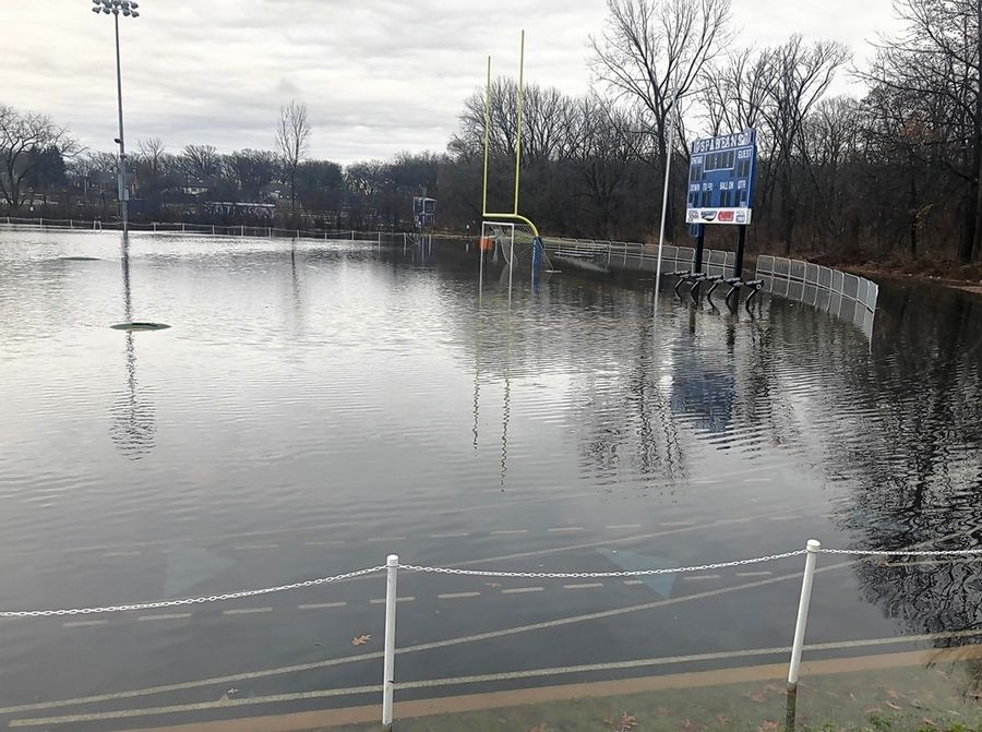 The athletic field and track at St. Francis High School was swamped after a rainstorm Dec. 2. School leaders are concerned about flooding issues if Roosevelt Road is widened.