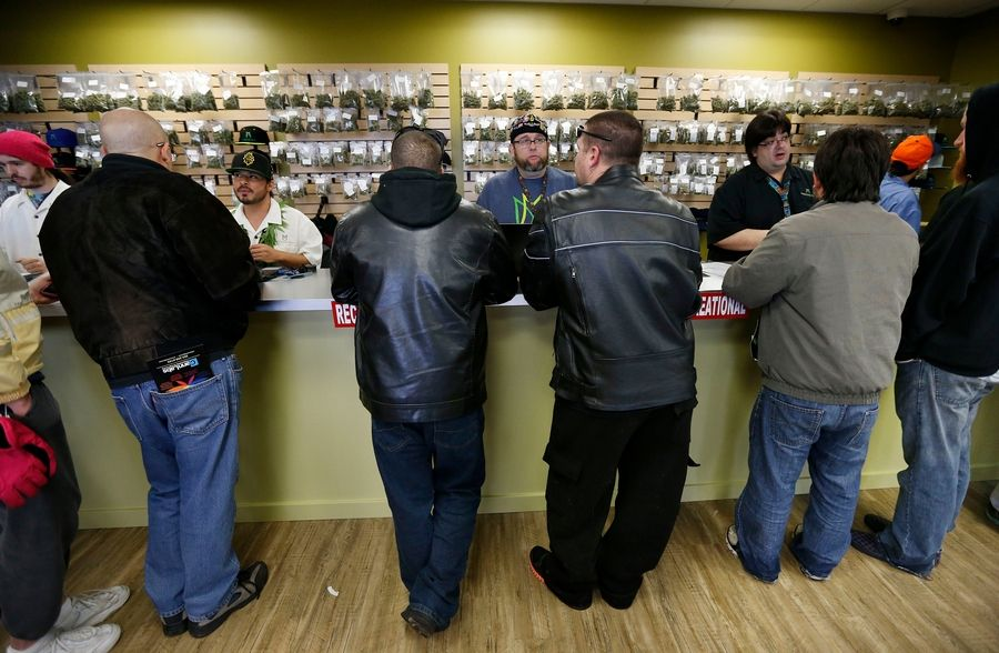 Buyers line up at a marijuana retailer in Colorado. Illinois Gov.-elect J.B. Pritzker aims for legalization of recreational marijuana use here, but one suburban lawmaker says not all Democrats are on board.