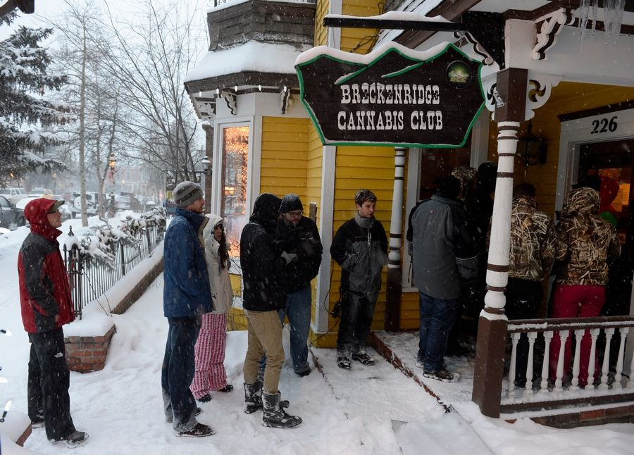 People wait in line outside the Cannabis Club on Main Street in downtown Breckenridge, Colorado, for the first legal recreational marijuana sales on Jan. 1, 2014.