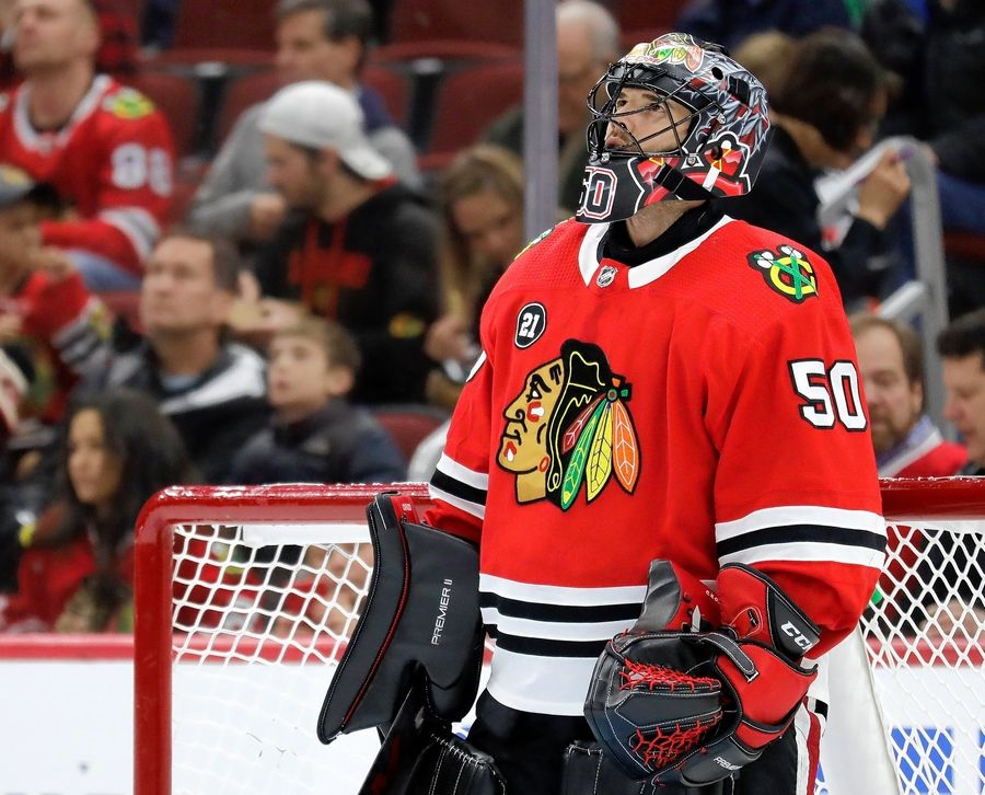 Chicago Blackhawks goalie Corey Crawford looks up the score board during the first period of an NHL hockey game against the Calgary Flames, Sunday, Dec. 2, 2018, in Chicago.