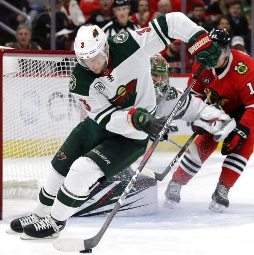 wholesale dealer b5a8c 6a523 Minnesota Wild center Charlie Coyle (3) controls the puck against the  Chicago Blackhawks during