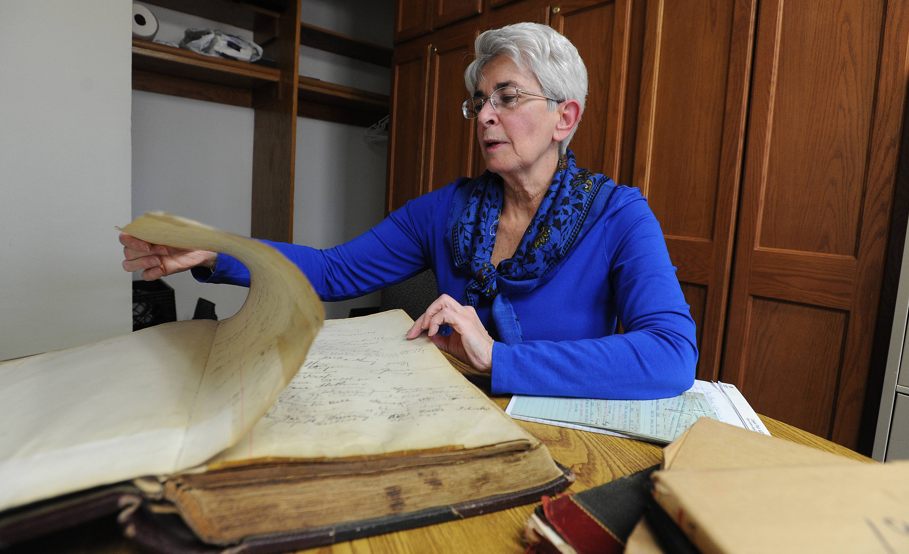 The penmanship is exquisite in these century-old record books discovered at Maryville Academy in Des Plaines. And there is a story behind every name, says compliance officer Mary Ellen D'Amato.
