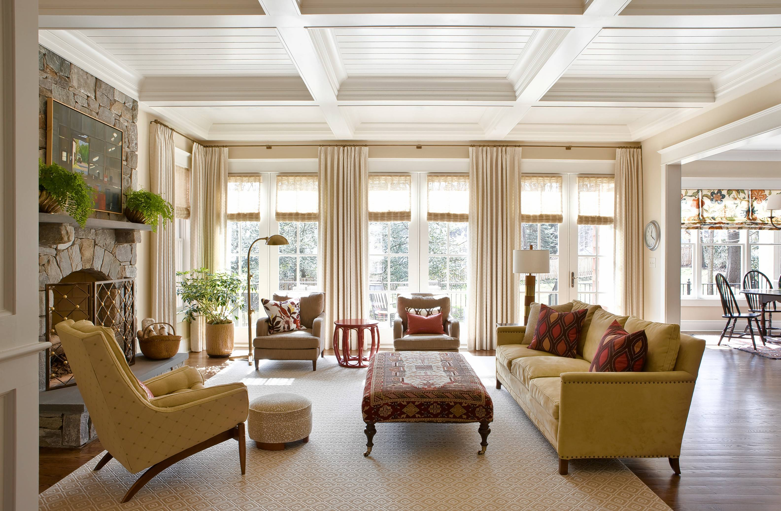 As 2019 approaches, Washington D.C.-based interior designer Marika Meyer sees a trend toward warm neutral colors and antique furniture in warm wood tones, as seen in this Virginia living room designed by Meyer.