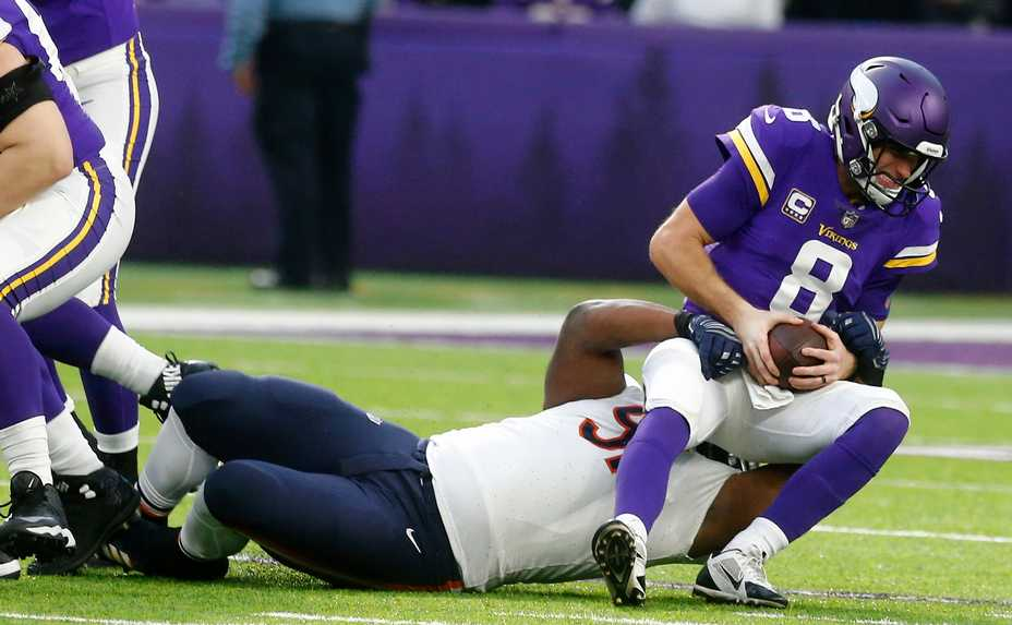 Minnesota Vikings Quarterback Kirk Cousins Is Sacked By Bears Nose Tackle Ed Goldman During The First