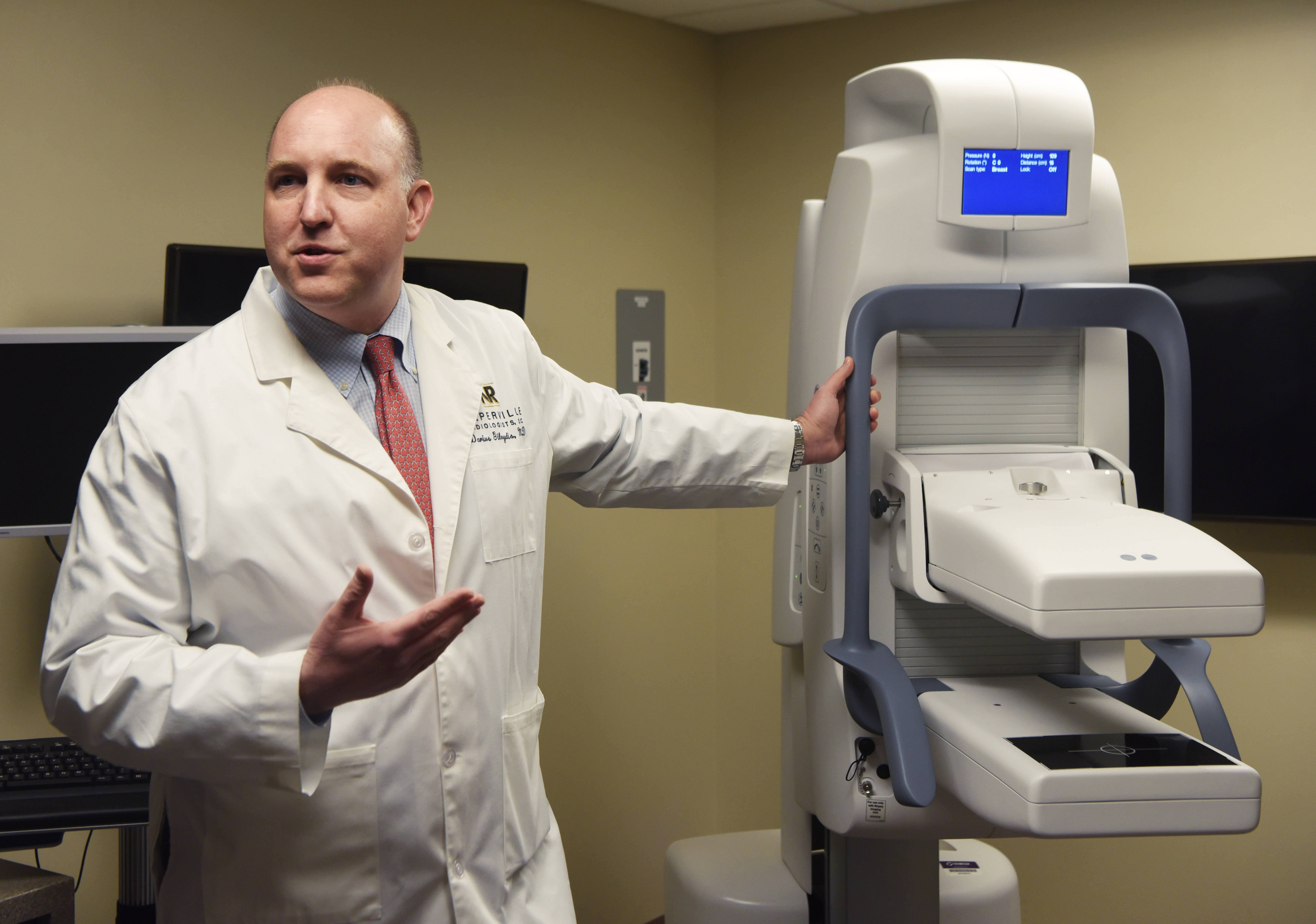 Dr. Darius Gilvydis, a diagnostic radiologist and medical director of breast imaging at Edward Hospital in Naperville, says the hospital's new molecular breast imaging machine helps identify cancerous cells in patients with dense breast tissue.