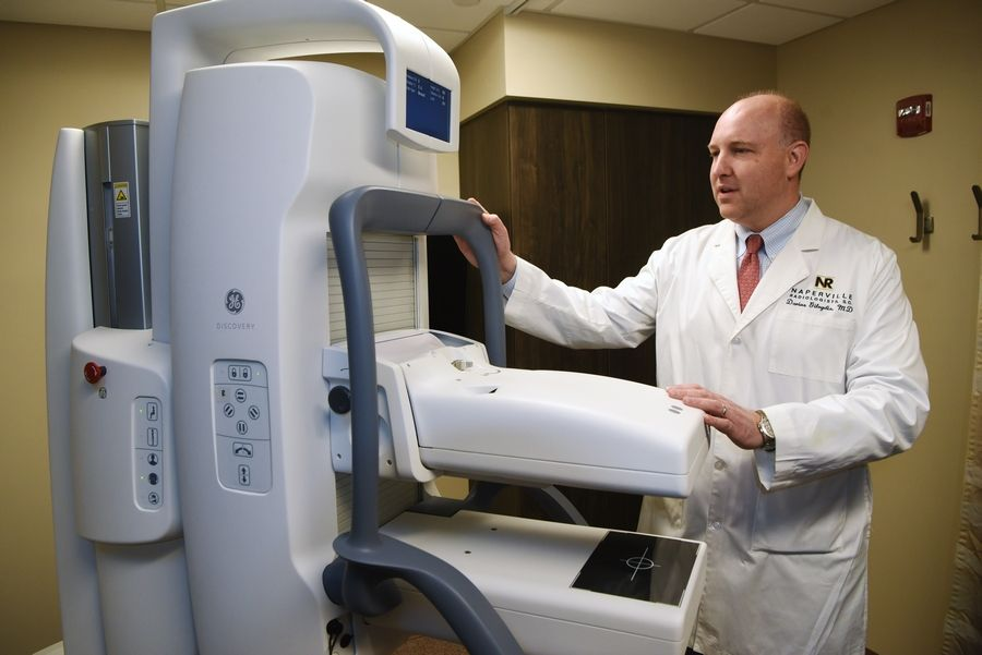 Dr. Darius Gilvydis, a diagnostic radiologist and medical director of breast imaging at Edward Hospital in Naperville, says Molecular Breast Imaging can provide reassurance to patients when they receive a negative result for breast cancer. The hospital is the first in the region to offer an MBI machine. Other facilities use ultrasounds or MRIs as follow-up screenings to mammograms to help diagnose cancer.