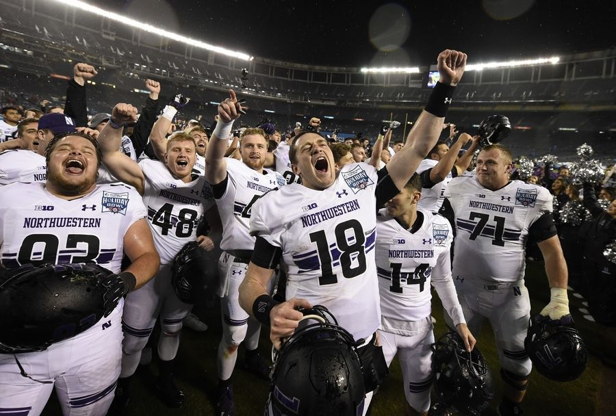Northwestern quarterback Clayton Thorson (18), and teammates celebrate after defeating Utah in the Holiday Bowl NCAA college football game Monday, Dec. 31, 2018, in San Diego.
