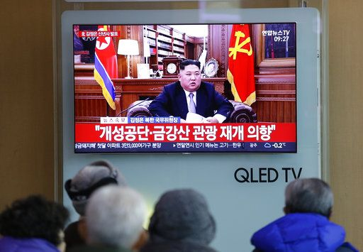 "People watch a TV news on a screen showing North Korean leader Kim Jong Un delivering a New Year's speech, at Seoul Railway Station in Seoul, South Korea, Tuesday, Jan. 1, 2019. The letters on the screen read: "" North Korea readies to restart operations at factory park jointly run with Seoul, resume tourism from South."" North Korean leader Kim says he hopes to extend his high-stakes nuclear summitry with President Donald Trump into 2019, but also warns Washington not to test North Koreans' patience with sanctions and pressure."
