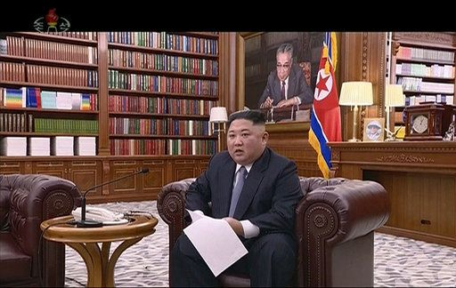 In this undated image from video distributed on Tuesday, Jan. 1, 2019, by North Korean broadcaster KRT, North Korean leader Kim Jong Un delivers a speech in North Korea. North Korean leader Kim says he hopes to extend his high-stakes nuclear summitry with President Donald Trump into 2019, but also warns Washington not to test North Koreans' patience with sanctions and pressure. (KRT via AP)