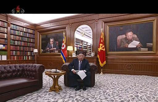 In this undated image from video distributed on Tuesday, Jan. 1, 2019, by North Korean broadcaster KRT, North Korean leader Kim Jong Un delivers a speech in North Korea. Kim says he hopes to extend his high-stakes nuclear summitry with President Donald Trump into 2019, but also warns Washington not to test North Koreans' patience with sanctions and pressure. Kim also during his New Year's speech said the United States should continue to halt its joint military exercises with ally South Korea. Nuclear talks between the countries have stalled.(KRT via AP)