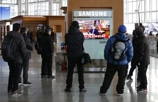 "People watch a TV news on a screen showing North Korean leader Kim Jong Un delivering a New Year's speech, at Seoul Railway Station in Seoul, South Korea, Tuesday, Jan. 1, 2019. The letters on the screen read: "" Nuclear power expansion."" North Korean leader Kim says he hopes to extend his high-stakes nuclear summitry with President Donald Trump into 2019, but also warns Washington not to test North Koreans' patience with sanctions and pressure."