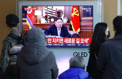 "People watch a TV news on a screen showing North Korean leader Kim Jong Un delivering a New Year's speech, at Seoul Railway Station in Seoul, South Korea, Tuesday, Jan. 1, 2019. The letters on the screen read: "" Seeking a new way."" North Korean leader Kim says he hopes to extend his high-stakes nuclear summitry with President Donald Trump into 2019, but also warns Washington not to test North Koreans' patience with sanctions and pressure."
