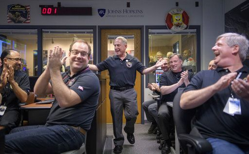 New Horizons principal investigator Alan Stern, center, of the Southwest Research Institute in Boulder, Colo., celebrates with other mission team members after they received signals from the New Horizons spacecraft that it is healthy and collected data during the flyby of Ultima Thule, Tuesday, Jan. 1, 2019, at the Mission Operations Center at the APL in Laurel, Md. (Bill Ingalls/NASA via AP)