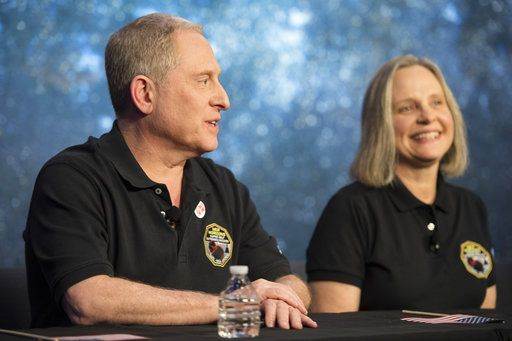 New Horizons principal investigator Alan Stern, left, speaks about the New Horizons spacecraft during a press conference after the team received confirmation from the spacecraft that it has completed a flyby of Ultima Thule, Tuesday, Jan. 1, 2019, at the Applied Physics Laboratory in Laurel, Md. Listening at right is mission operations manager Alice Bowman The spacecraft survived the most distant exploration of another world, a tiny, icy object 4 billion miles away that looks to be shaped like a peanut or bowling  pin. (Joel Kowsky/NASA via AP)