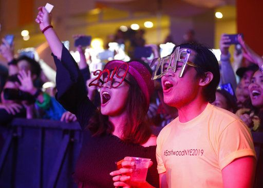 Filipinos cheer during a New Year countdown at the Eastwood Shopping Mall late Monday, Dec. 31, 2018 in suburban Quezon city northeast of Manila, Philippines. Filipinos welcome the New Year with the loudest noise possible including setting off powerful firecrackers in one of Asia's most violent celebrations.