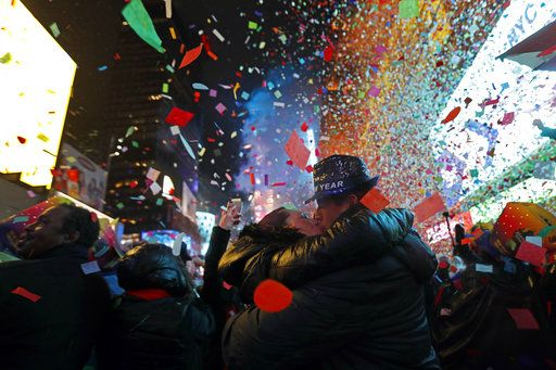 Joey and Claudia Flores, of California, kiss as confetti falls during a New Year's celebration in New York's Times Square, Tuesday, Jan. 1, 2019.