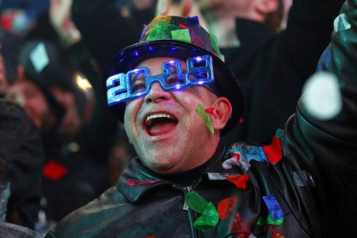 A reveler celebrates as confetti falls during a New Year's celebration in New York's Times Square, Tuesday, Jan. 1, 2019.