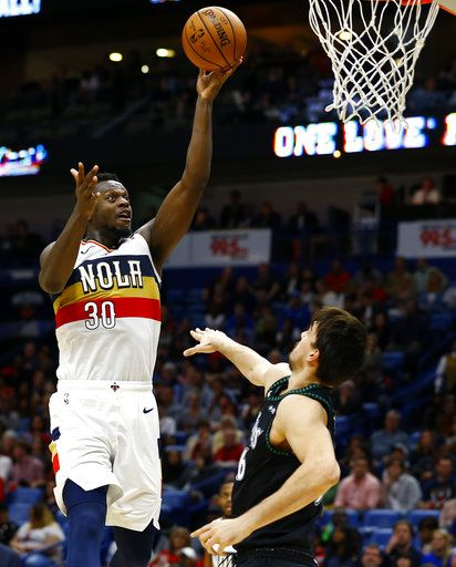 New Orleans Pelicans forward Julius Randle (30) shoots over Minnesota Timberwolves forward Dario Saric (36) during the second half of an NBA basketball game, Monday, Dec. 31, 2018, in New Orleans.