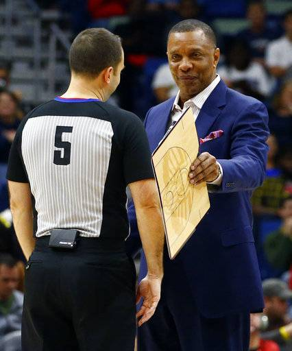 New Orleans Pelicans head coach Alvin Gentry, right, talks with referee Kane Fitzgerald (5) during the first half of an NBA basketball game, Monday, Dec. 31, 2018, in New Orleans.