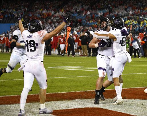 Northwestern offensive lineman Trey Klock (39), center, is congratulated by wide receiver Ramaud Chiaokhiao-Bowman (81) after scoring a touchdown during the second half of the Holiday Bowl NCAA college football game against Utah, Monday, Dec. 31, 2018, in San Diego.
