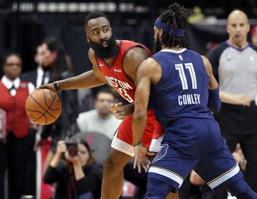 Houston Rockets guard James Harden (13) looks to pass the ball under pressure from Memphis Grizzlies guard Mike Conley (11) during the first half of an NBA basketball game Monday, Dec. 31, 2018, in Houston.