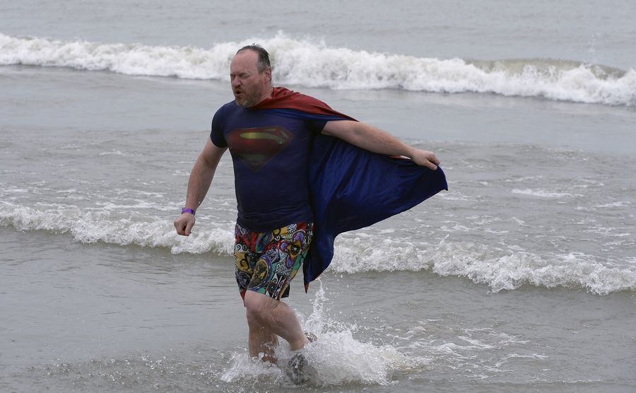 Peter Bonate of Libertyville dressed as Superman to take the 20th annual Polar Bear Plunge on Tuesday in Lake Michigan.
