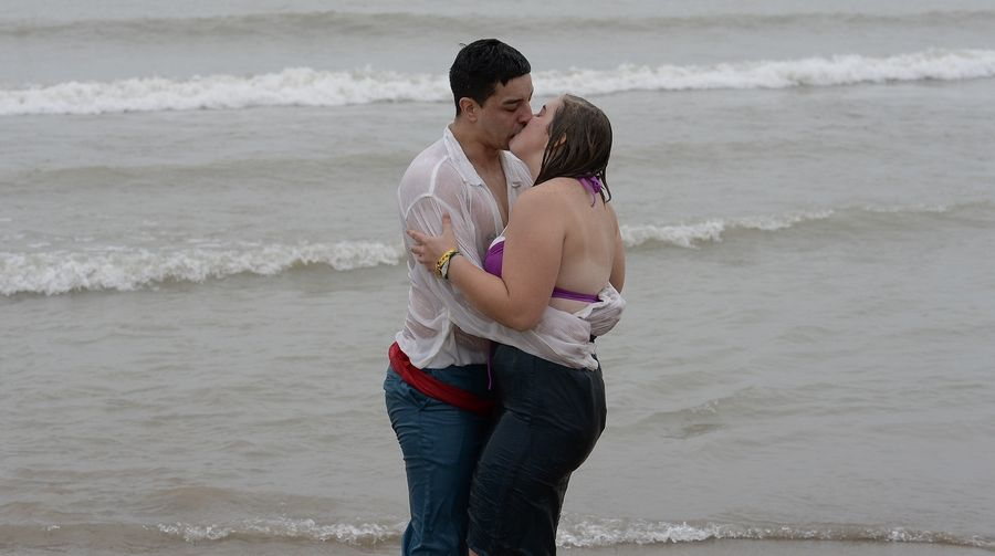 "Eric Bonilla of Waukegan and his girlfriend, Lynsey Gallagher of Kenosha, Wisconsin, embrace during the Polar Bear Plunge on Tuesday. ""Getting in the water is not so bad,"" Gallagher said. ""It's getting out."""