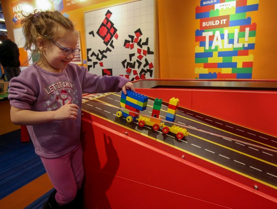 Naperville 4-year-old Sullivan Moeller moves a train at the DuPage Children's Museum, where researchers are studying how kids learn from playing.