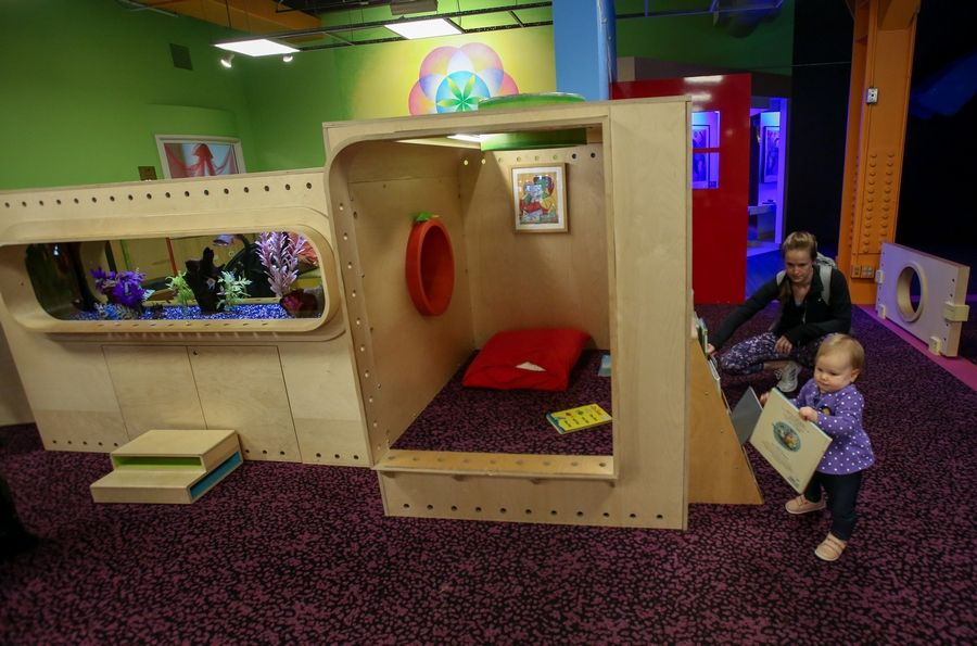 Arianne Bonifas of Bolingbrook plays with her daughter, 14-month-old Riley, at the DuPage Children's Museum in Naperville. The museum has conducted research that has found many parents and caregivers feel unsure about how to engage their little ones in playful learning.