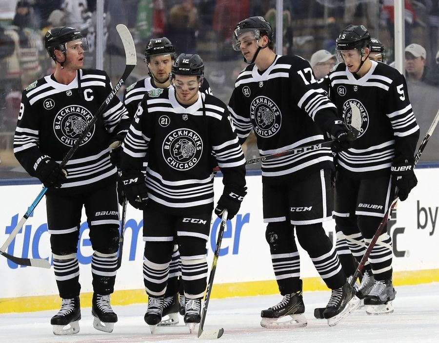 Chicago Blackhawks players react to the team s 4-2 loss to the Boston Bruins  in ea11444ce