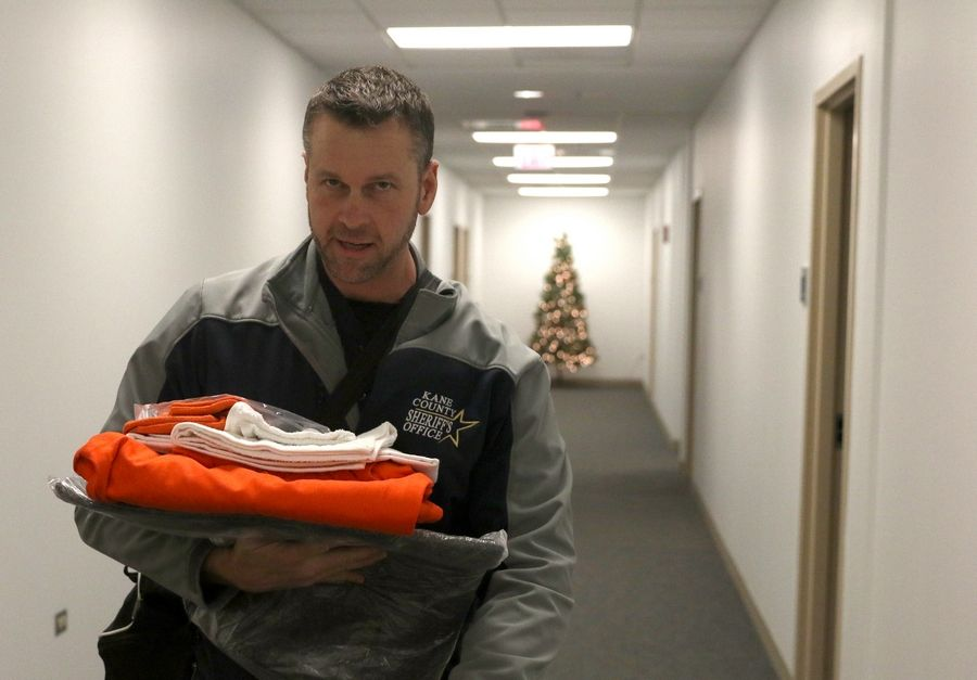Kane County Sheriff Ron Hain was given the standard-issue orange T-shirt, orange pants, sandals, socks and underwear that includes a short-sleeved T-shirt for his night in the jail.