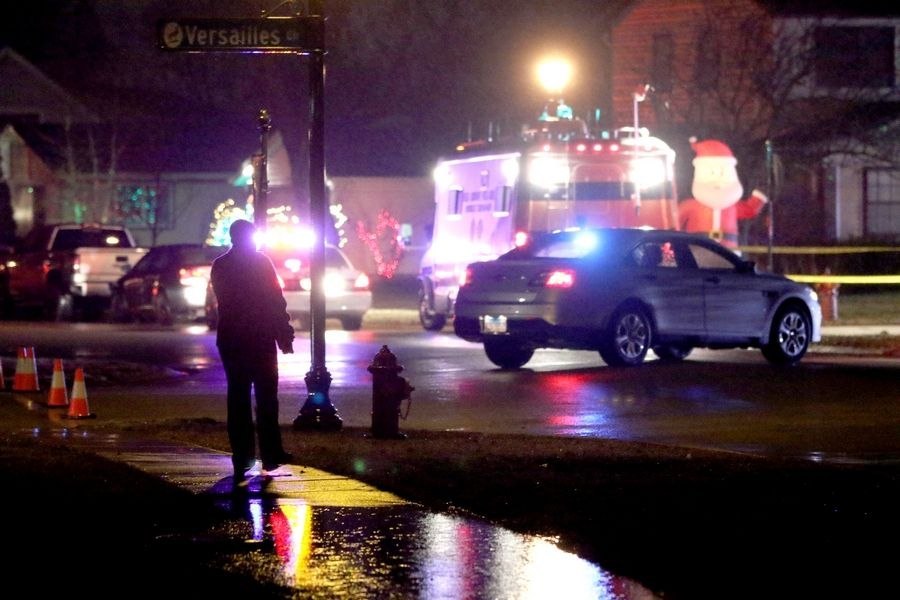 Police monitor a scene Monday night on West Brantwood Avenue at Chelmsford Lane in Elk Grove Village after a postal worker was shot there. An Elk Grove Village man has been charged, authorities announced Wednesday.