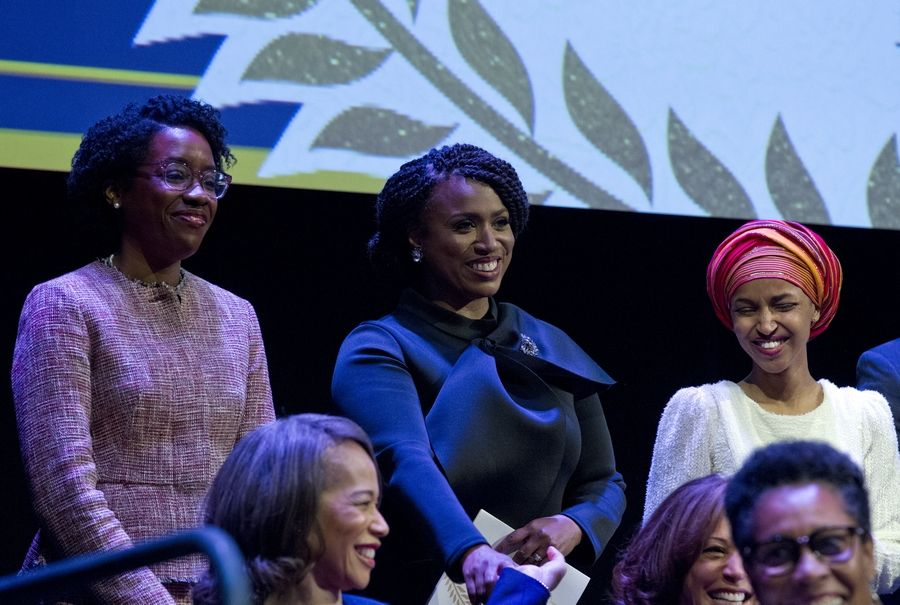From left, Lauren Underwood, a Naperville Democrat, Ayanna Pressley, a Massachusetts Democrat, and Ilhan Omar, a Minnesota Democrat, Thursday during the swearing-in ceremony of Congressional Black Caucus members of the 116th Congress at The Warner Theatre in Washington.