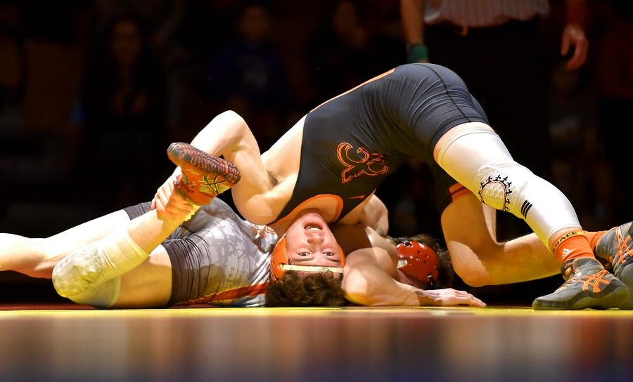 St. Charles East's Tommy Schroeder holds the leg of Batavia's Justin Major in their 160-bound bout Thursday in a wrestling match in Batavia.