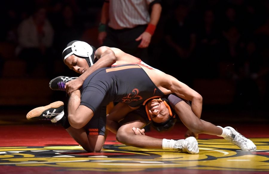 Batavia's Geremy Lewis controls St. Charles East's Jack Baniewick in their 106-pound bout Thursday in a wrestling match in Batavia.