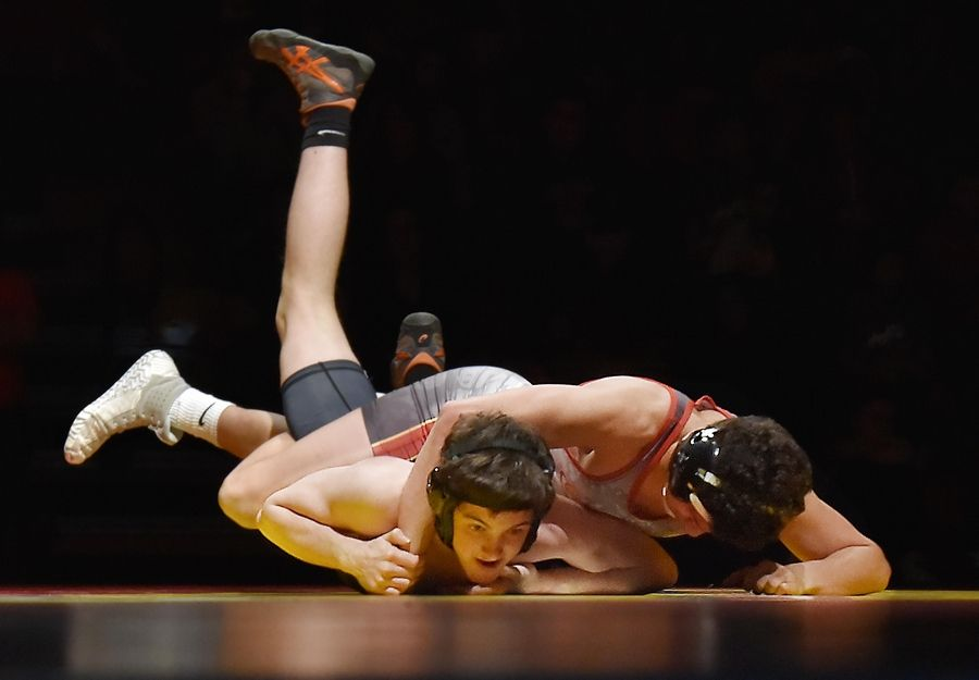 Batavia's Alex Cruz tries to control St. Charles East's Peyton Schroeder in their 132-pound bout Thursday in a wrestling match in Batavia.