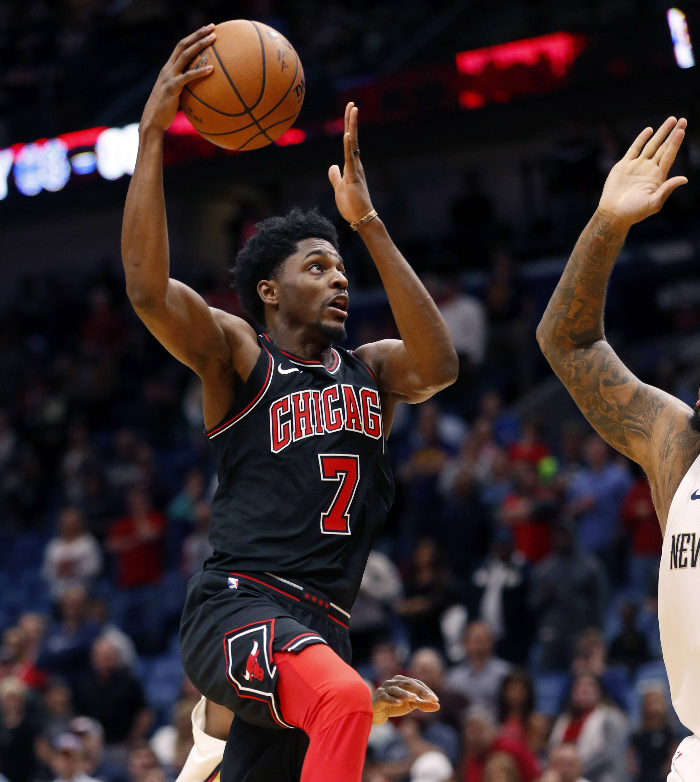 Bulls trade Holiday to Memphis, plan to waive Payne