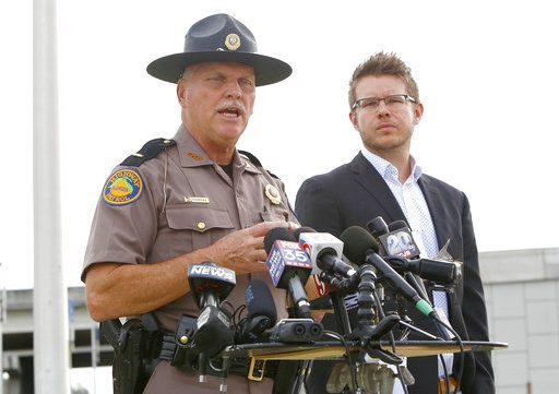 Florida Highway Patrol Lt. Pat Riordan, left, along with Troy Roberts, the spokesperson for the Florida Department of Transportation,  updates members the media during a press conference, Friday, Jan. 4, 2019, in Gainesville, Fla., about a fiery highway crash the day before that killed at least seven people. (Brad McClenny/The Gainesville Sun via AP)