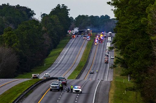 Interstate 75 is shut down both directions after a wreck with multiple fatalities on Thursday, Jan. 3, 2019. Seven people died and at least eight more were injured, some of them critically, in the multi-vehicle crash. (Lauren Bacho/The Gainesville Sun via AP)